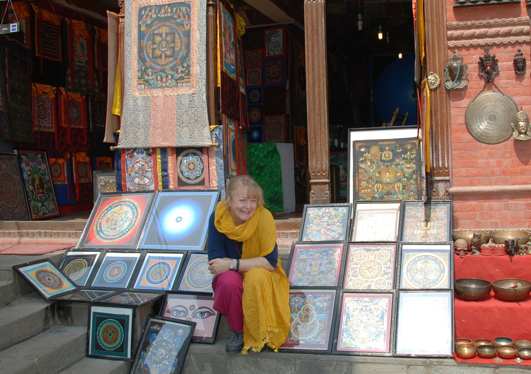 Carolyn sitting at a tanka shop at Swayambhunath Stupa, Kathmandu