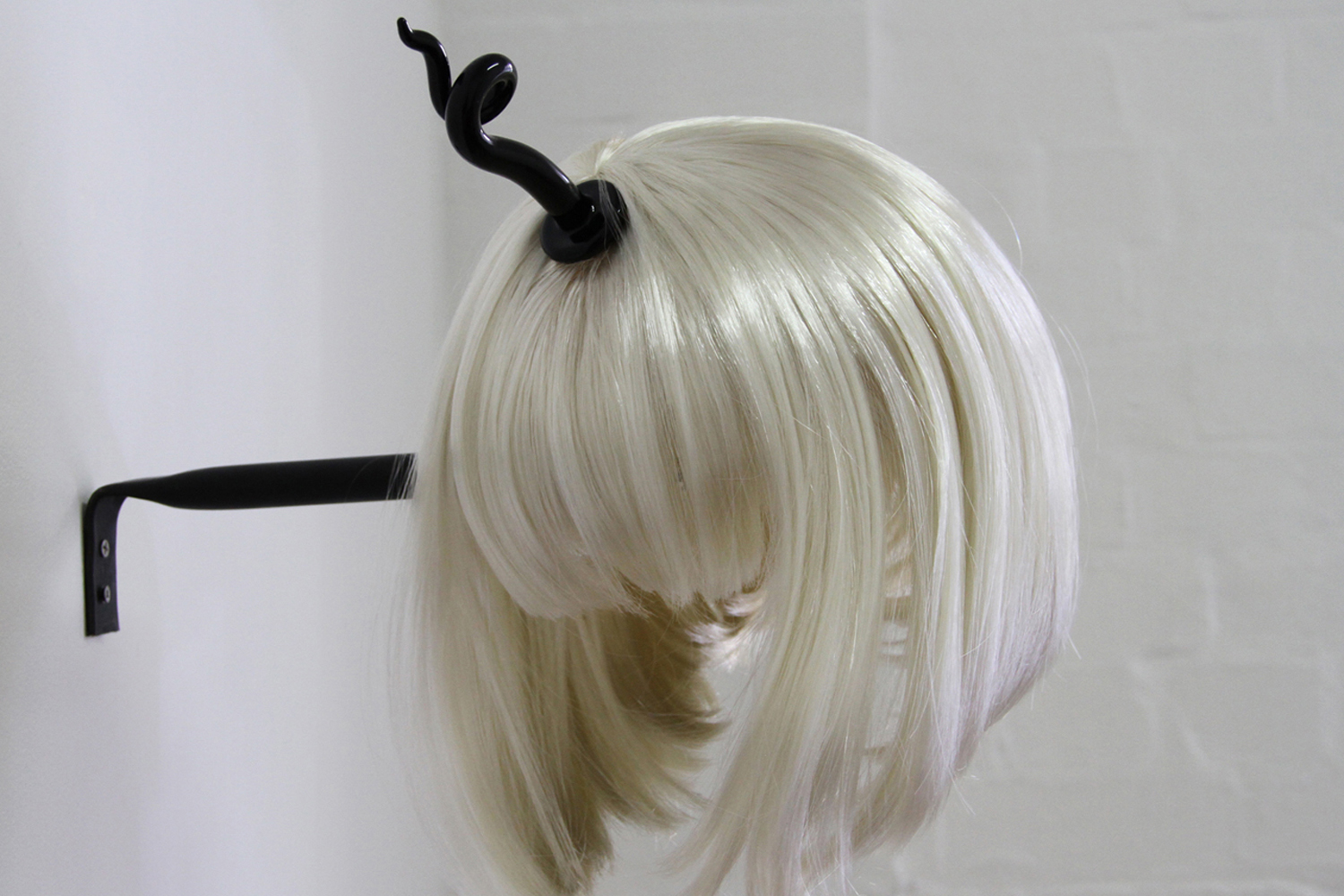 Anastasia Booth Unicorn, 2014, synthetic hair, glass and steel. 20 x 25 x3 0cm.