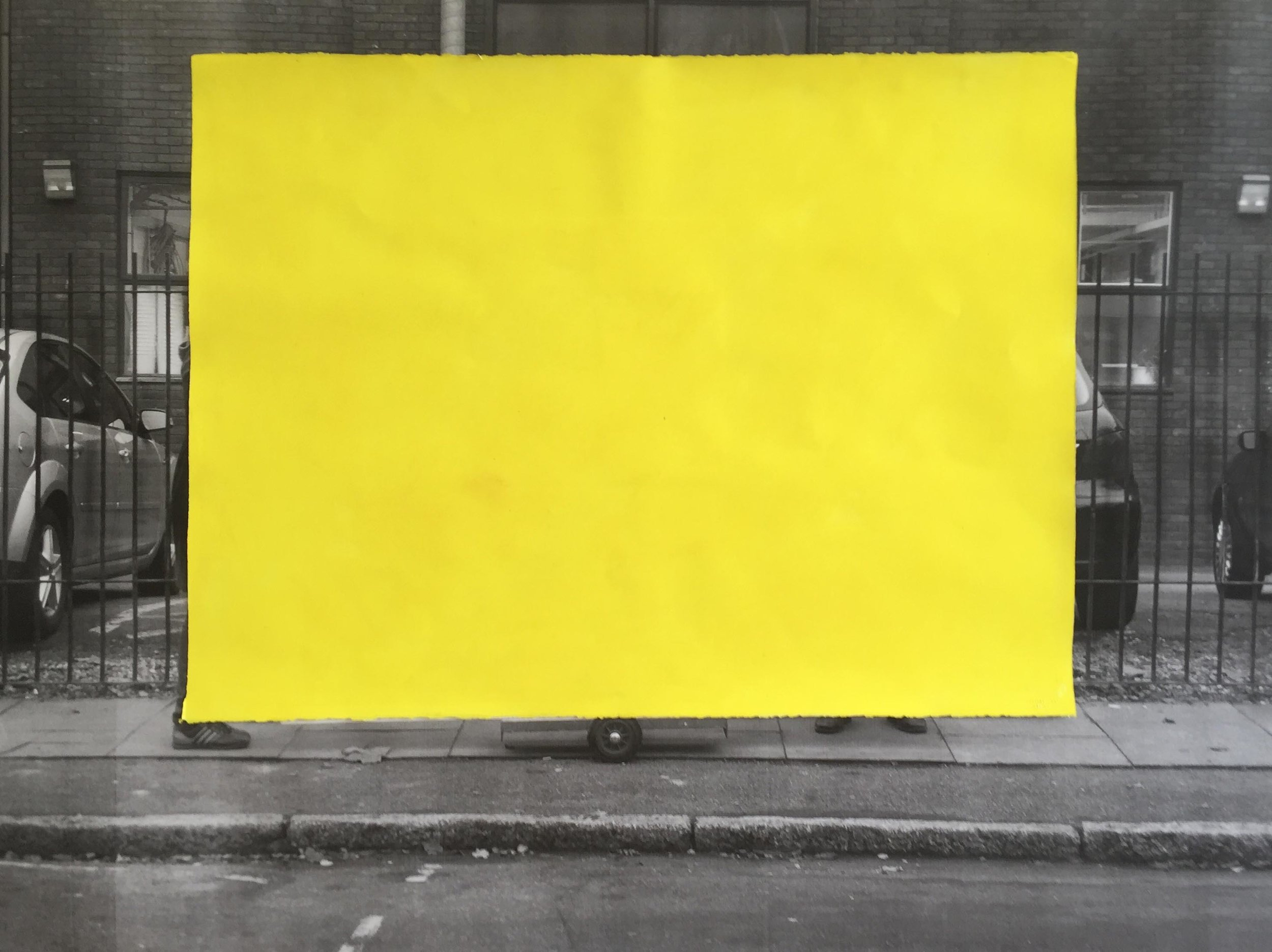 David Thomas,  Taking a monochrome for a walk (yellow) , 2017-18. Acrylic on paper over laser print. Courtesy the artist.