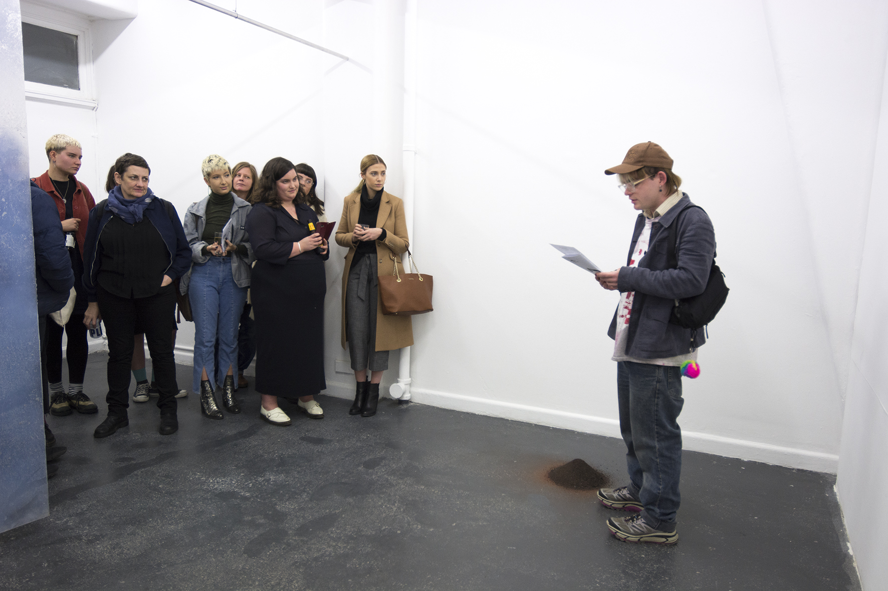Daniel Ward, reading at opening of Erin Hallyburton + Stephanie Hosler,  There is a wall dissolving , BLINDSIDE 2019. Photo Talia Carroll | Courtesy the artists.