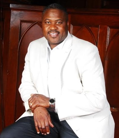 Copy of Pastor white jacket in front of pulpit.jpg