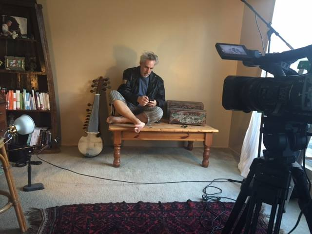 Stephen Day on set preparing for a Sarod solo