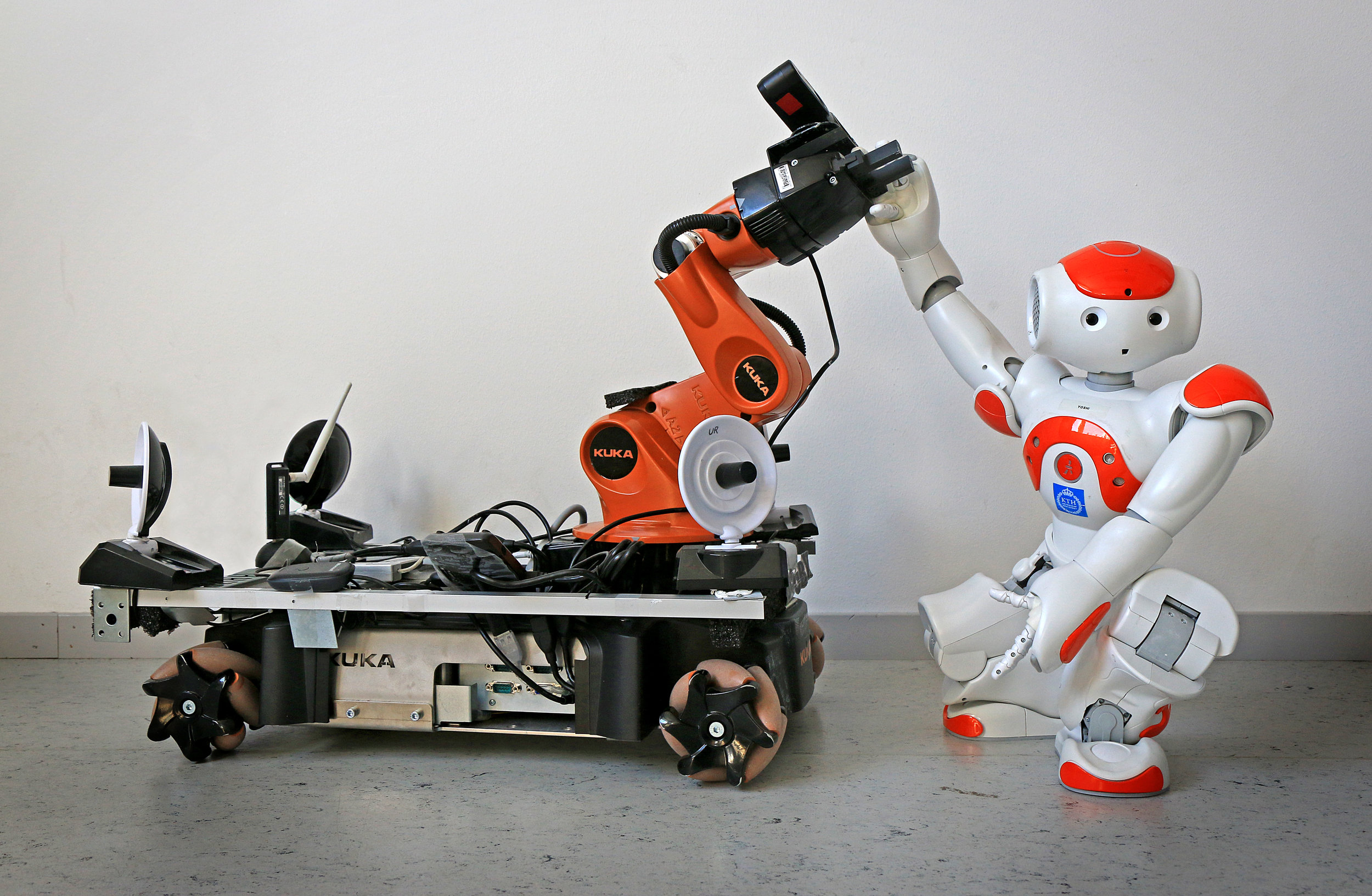 ' They have taught robots to cooperate ' by Peter Larsson ( CC BY 3.0 ), via Wikimedia Commons.