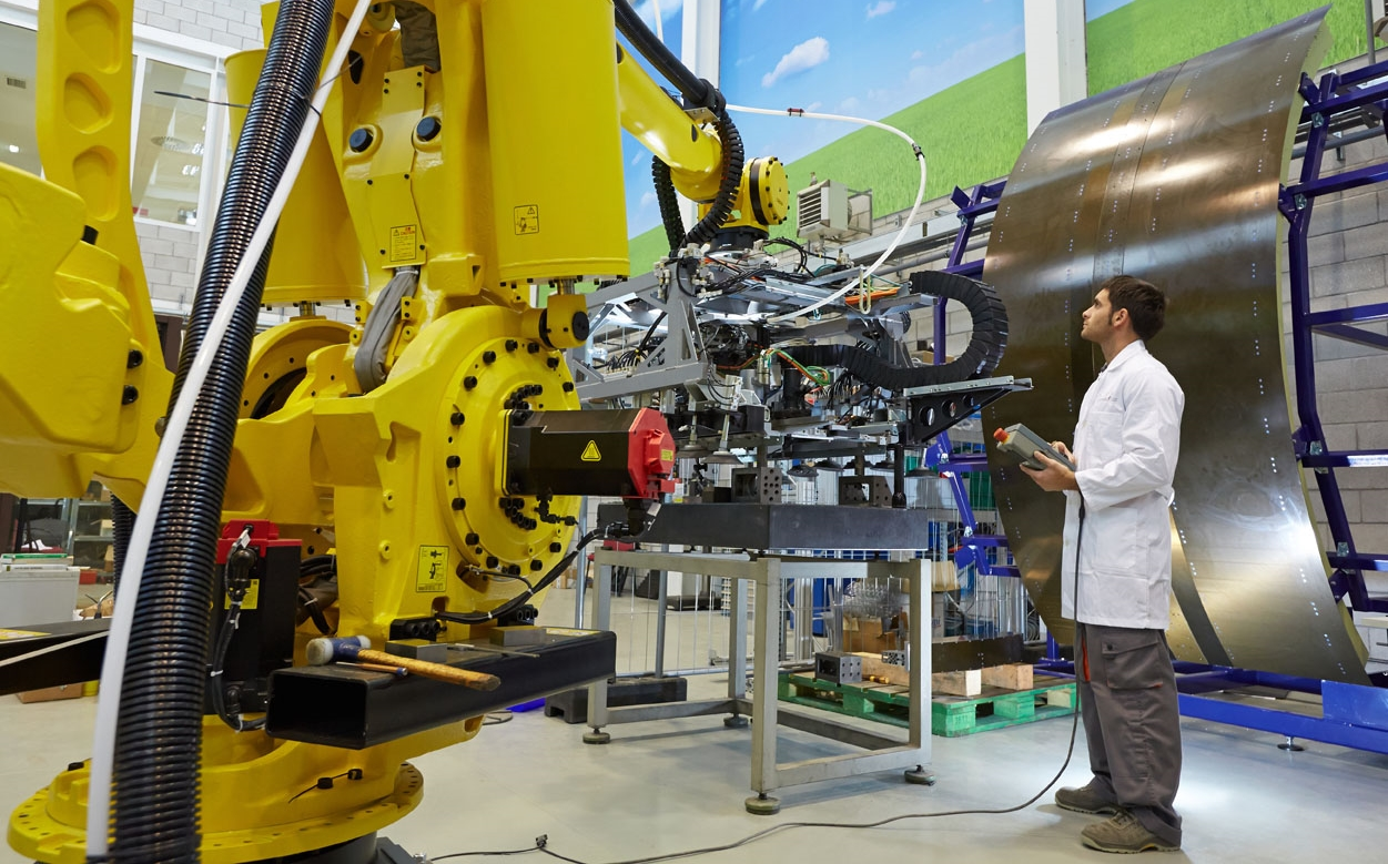 ' Robotic Manufacturing Cell 'by Tecnalia ( CC BY-NC-ND 2.0 ), via Flickr.