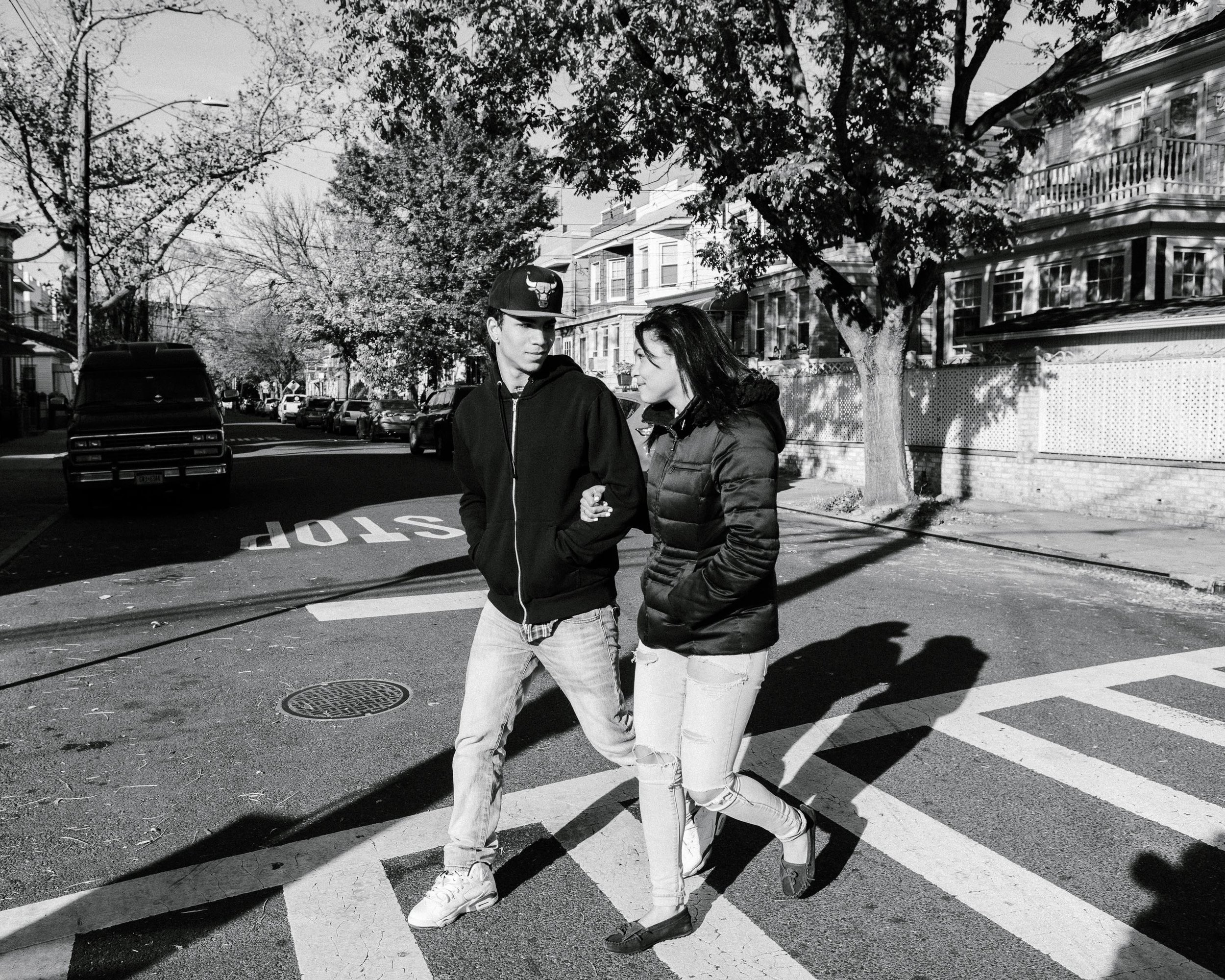 Andreina walking with her boyfriend, Drehelin, Queens NY. By Laurel Golio.