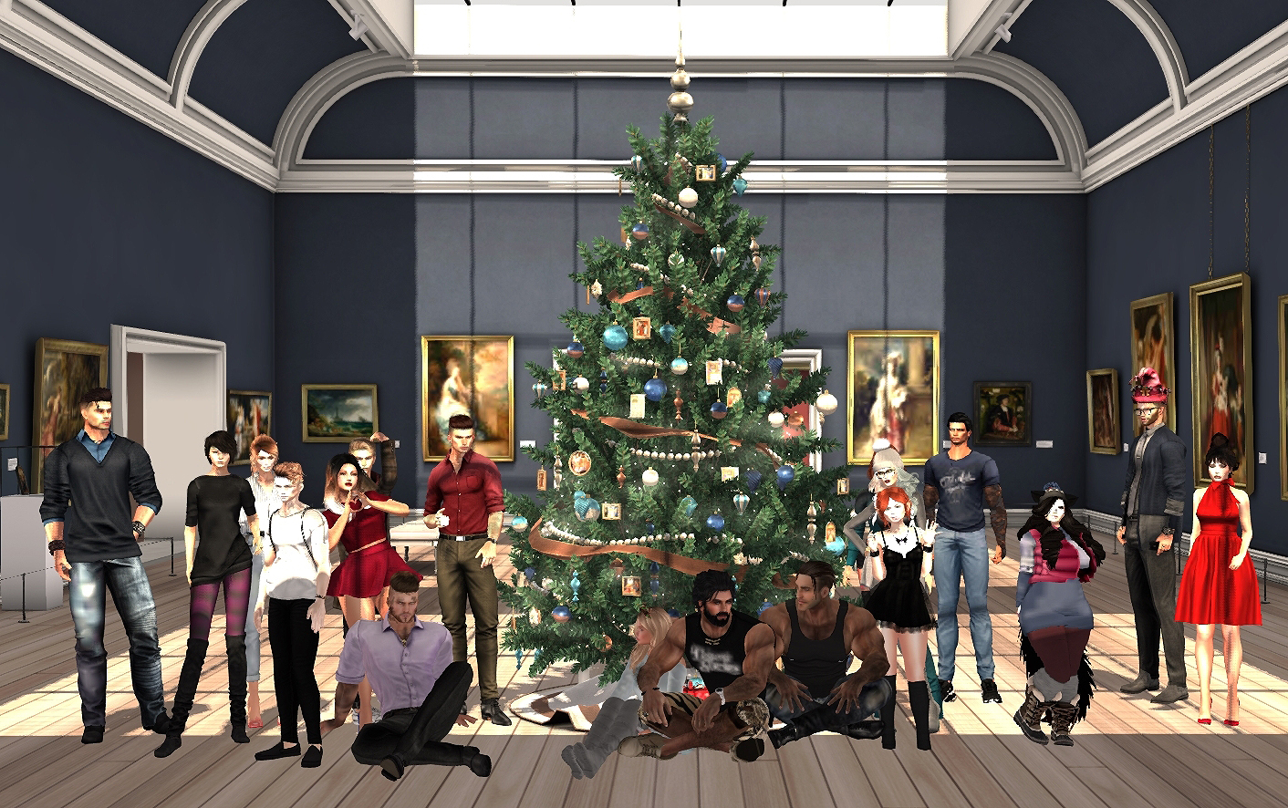 A group photo at the end of the even with the fully-decorated Christmas tree.