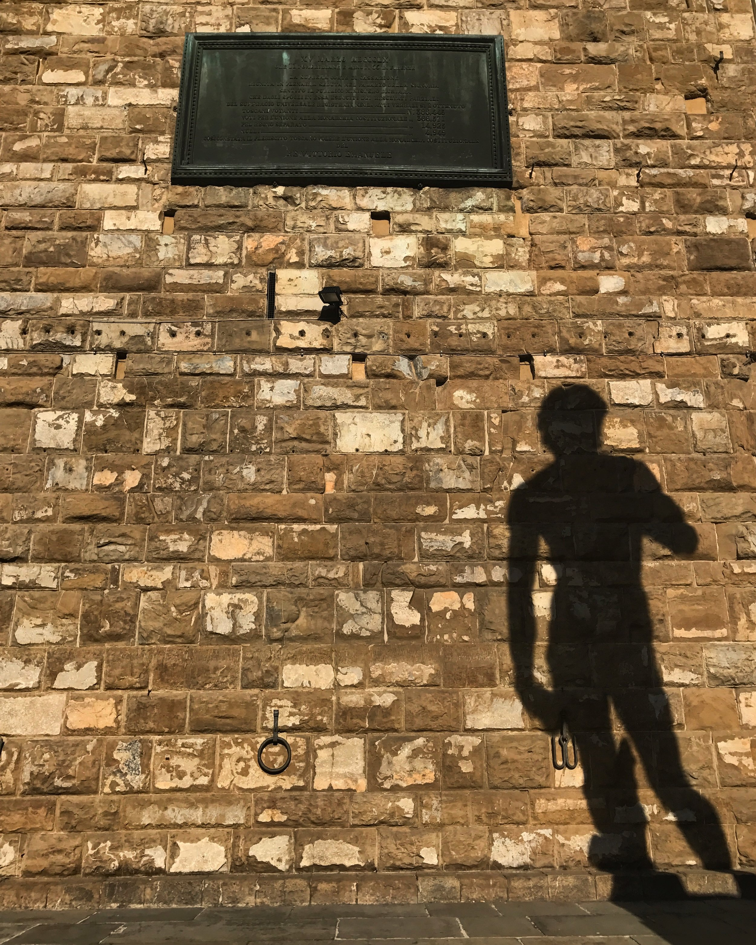 Shadow of the copy of the David outside Palazzo Vecchio, Florence
