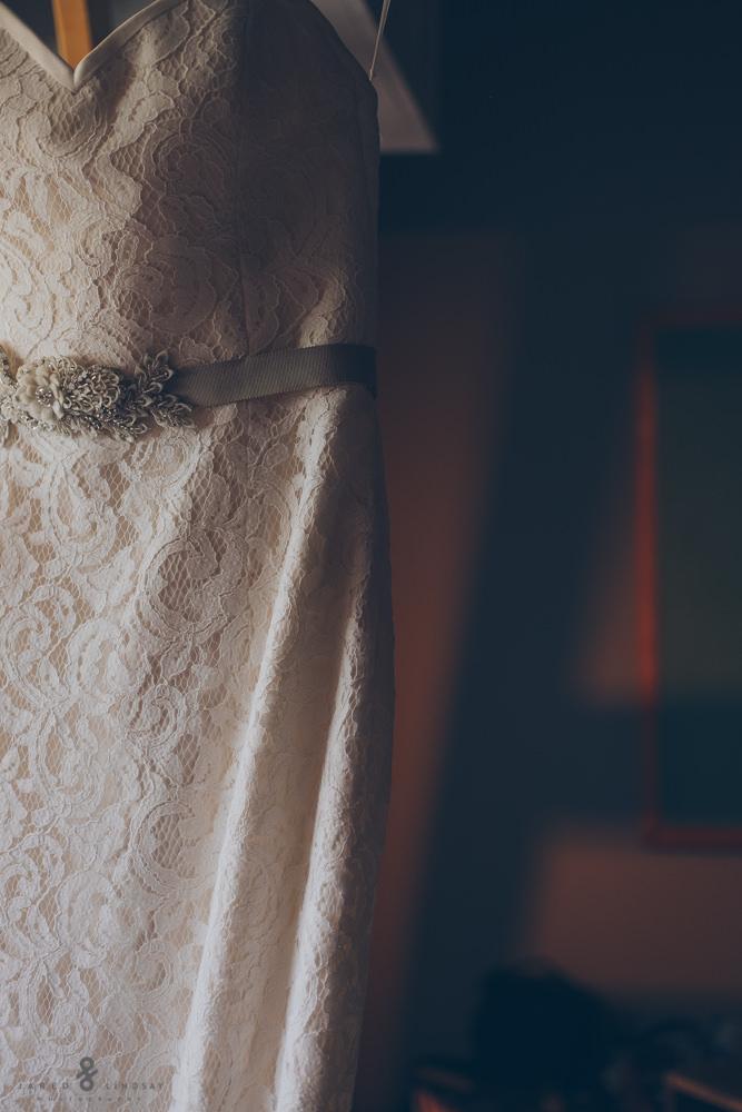 Photo of wedding dress hanging up
