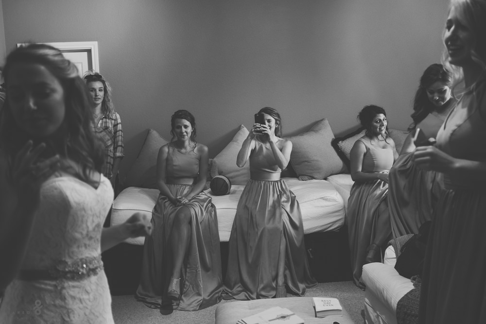 Bride and bridesmaids getting ready in house
