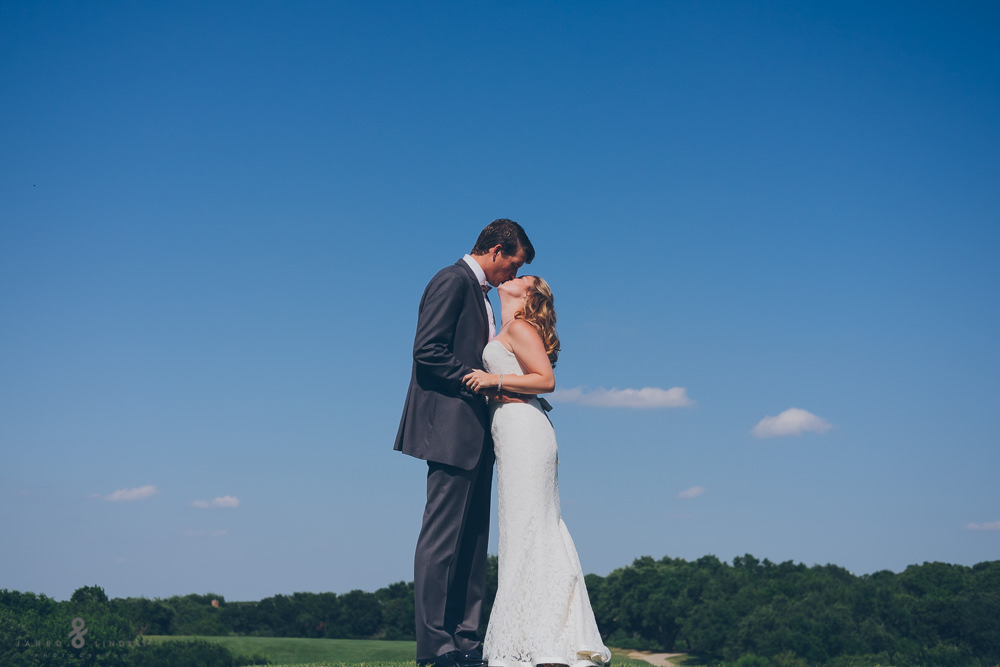 bride and groom kissing during their first look in Texas wedding