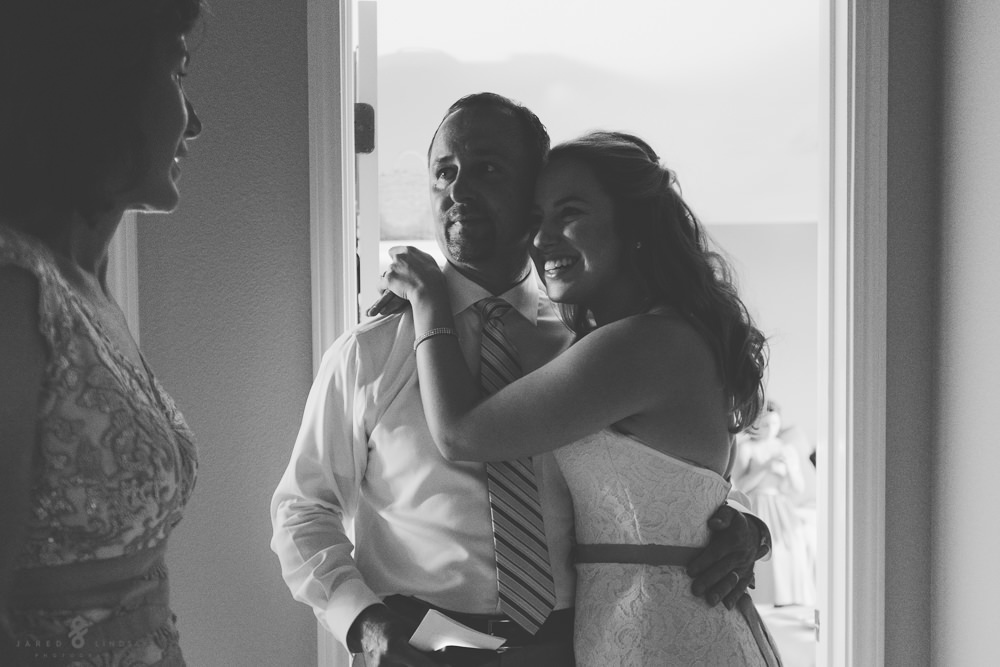 Bride hugging father of the bride before wedding ceremony