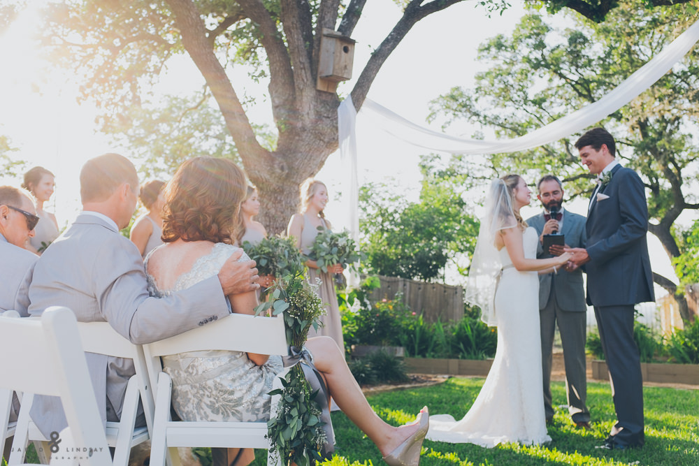 Bride and groom getting married at wedding ceremony