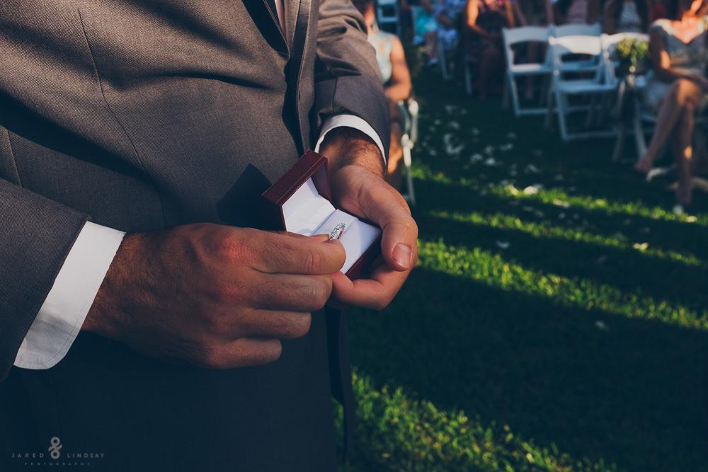 Best man holding wedding ring during wedding ceremony