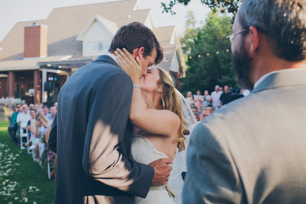Bride and groom kissing at Texas wedding ceremony