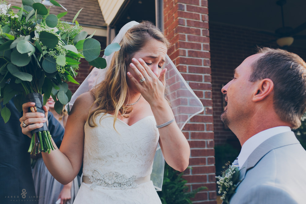 Bride crying with father after wedding ceremony in Texas