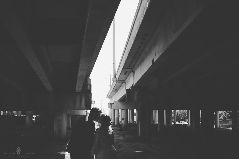 Bride and groom under bridge for portrait shoot