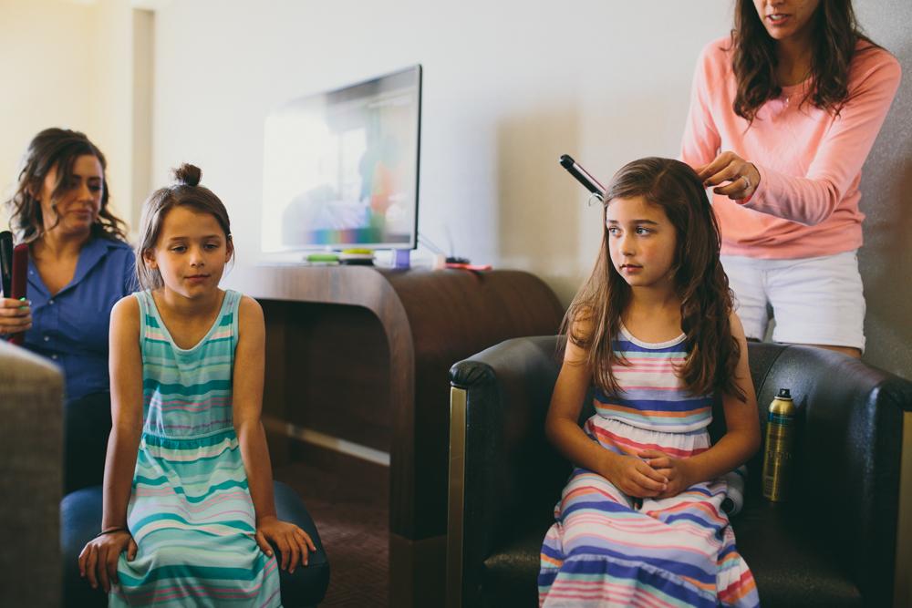 Little girls getting ready before wedding in Texas