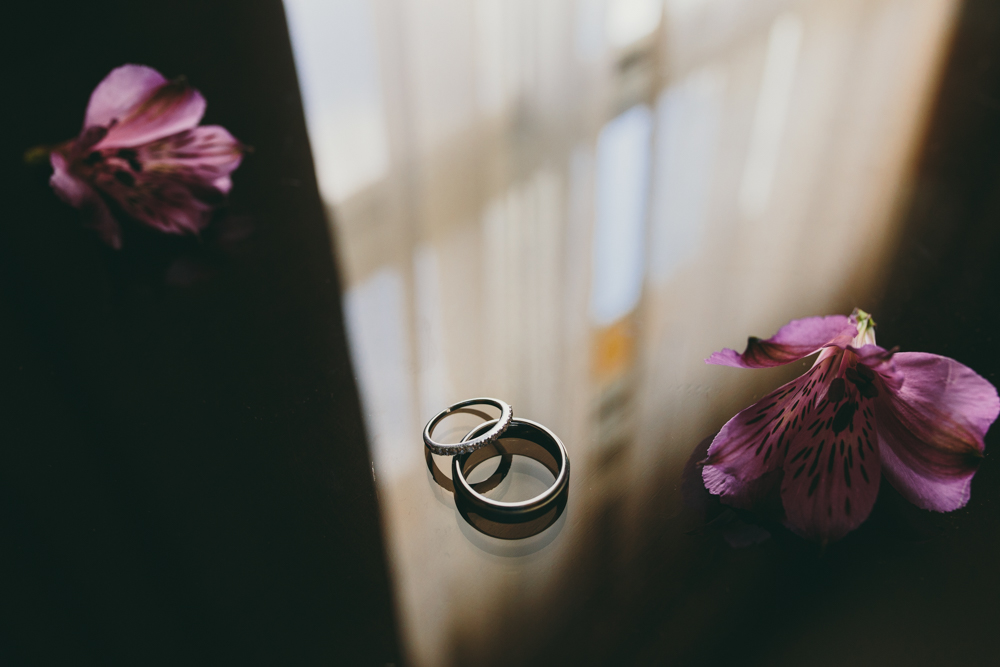 Photo of wedding rings on table