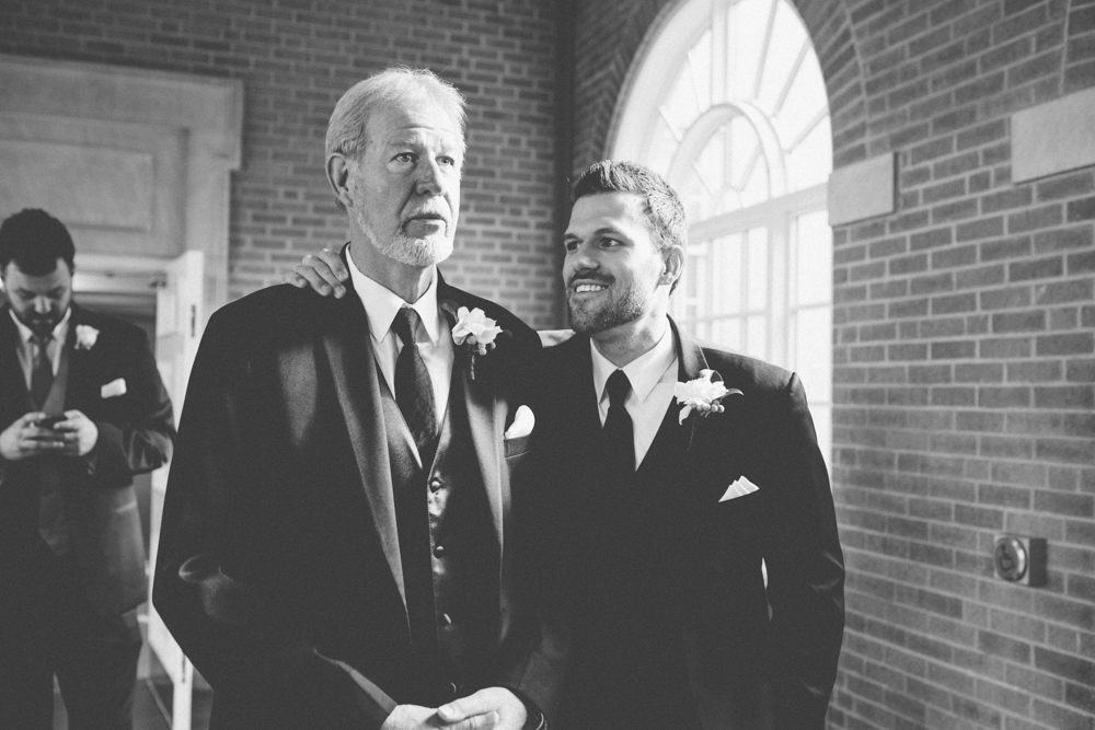 Father of bride standing next to groom before ceremony at TCU chapel
