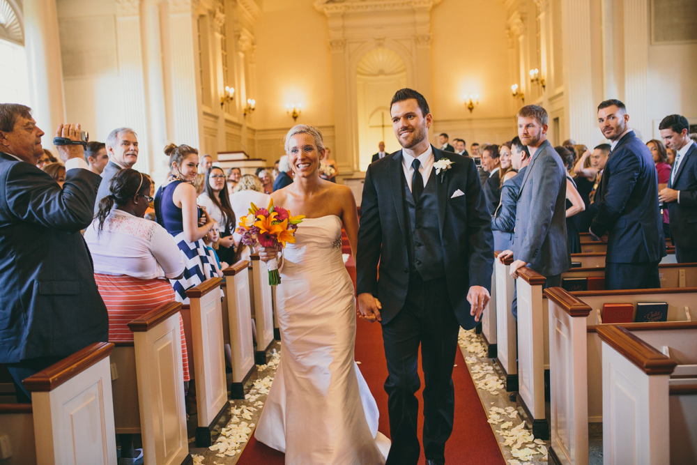 Bride and groom walking down isle after wedding ceremony at TCU chapel