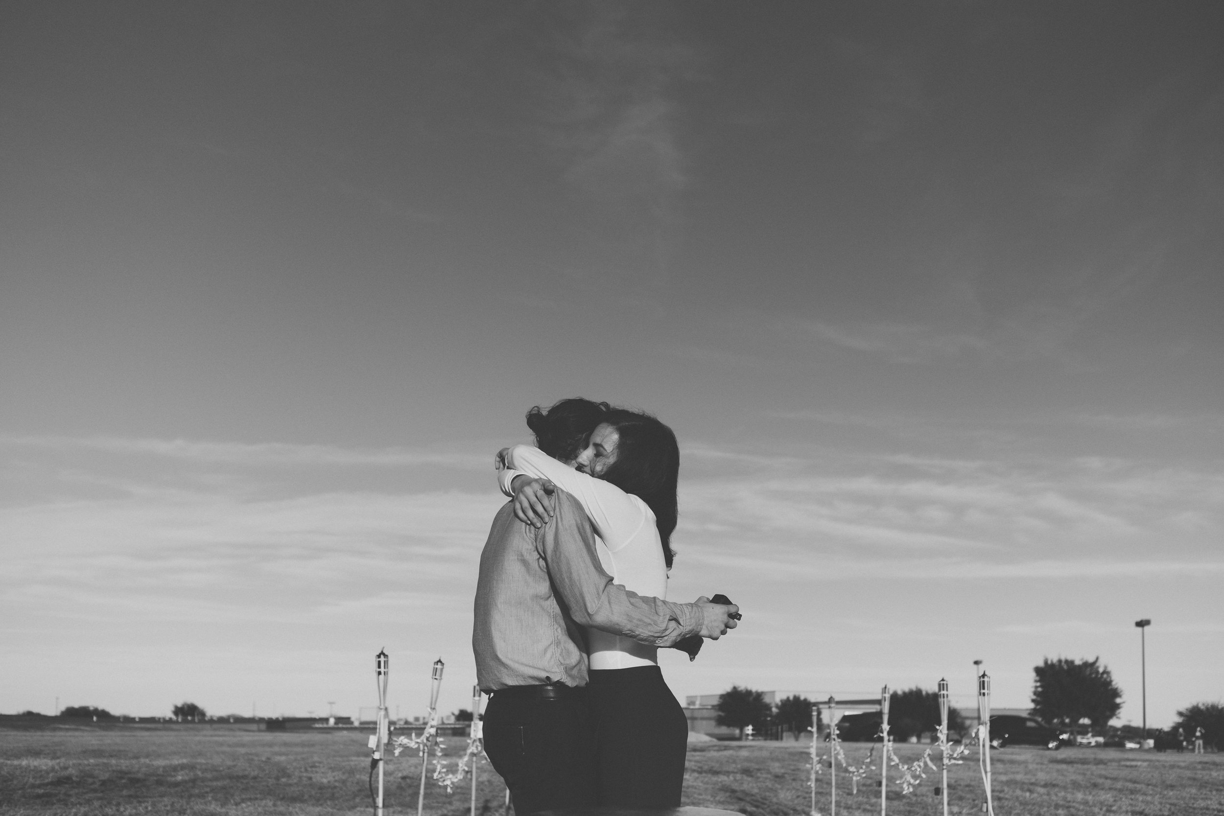 Black and white photo of man and woman hugging