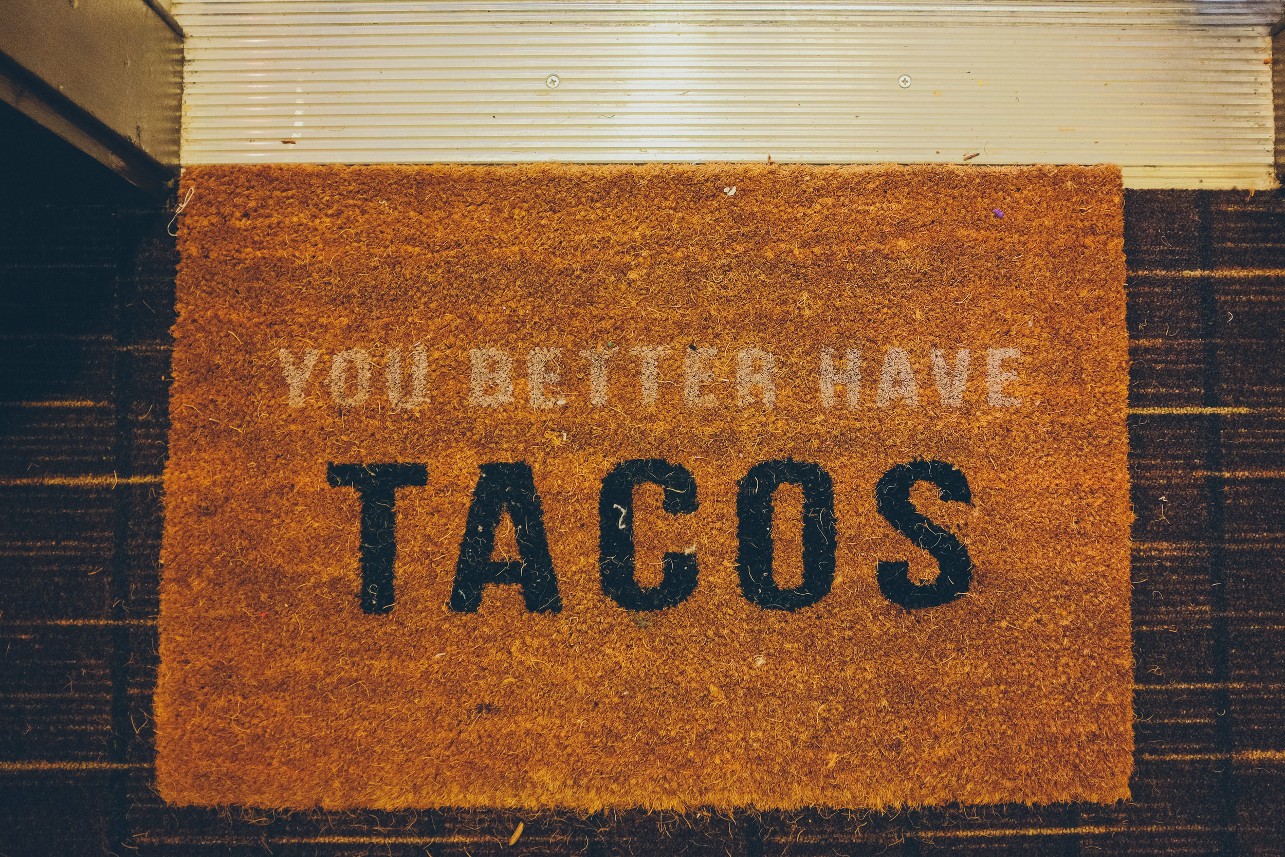 "Door mat that says ""you better have tacos"""