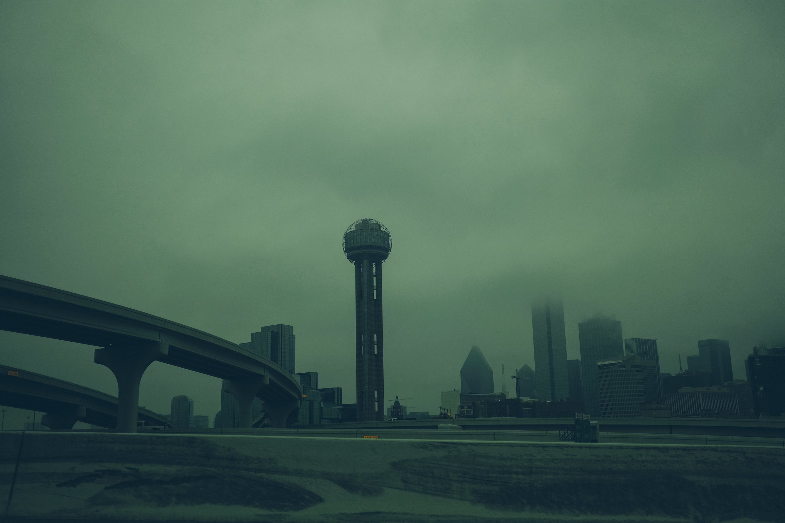 Cloudy photograph of downtown Dallas, Texas.