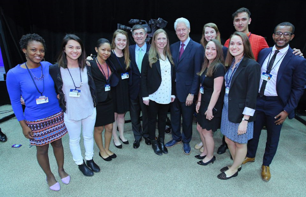 Sam (far right) with Bill and Chelsea Clinton at the Clinton Global Initiative University in April 2016