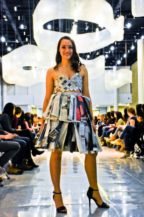 Sam modeling her outfit made completely out of newspaper!