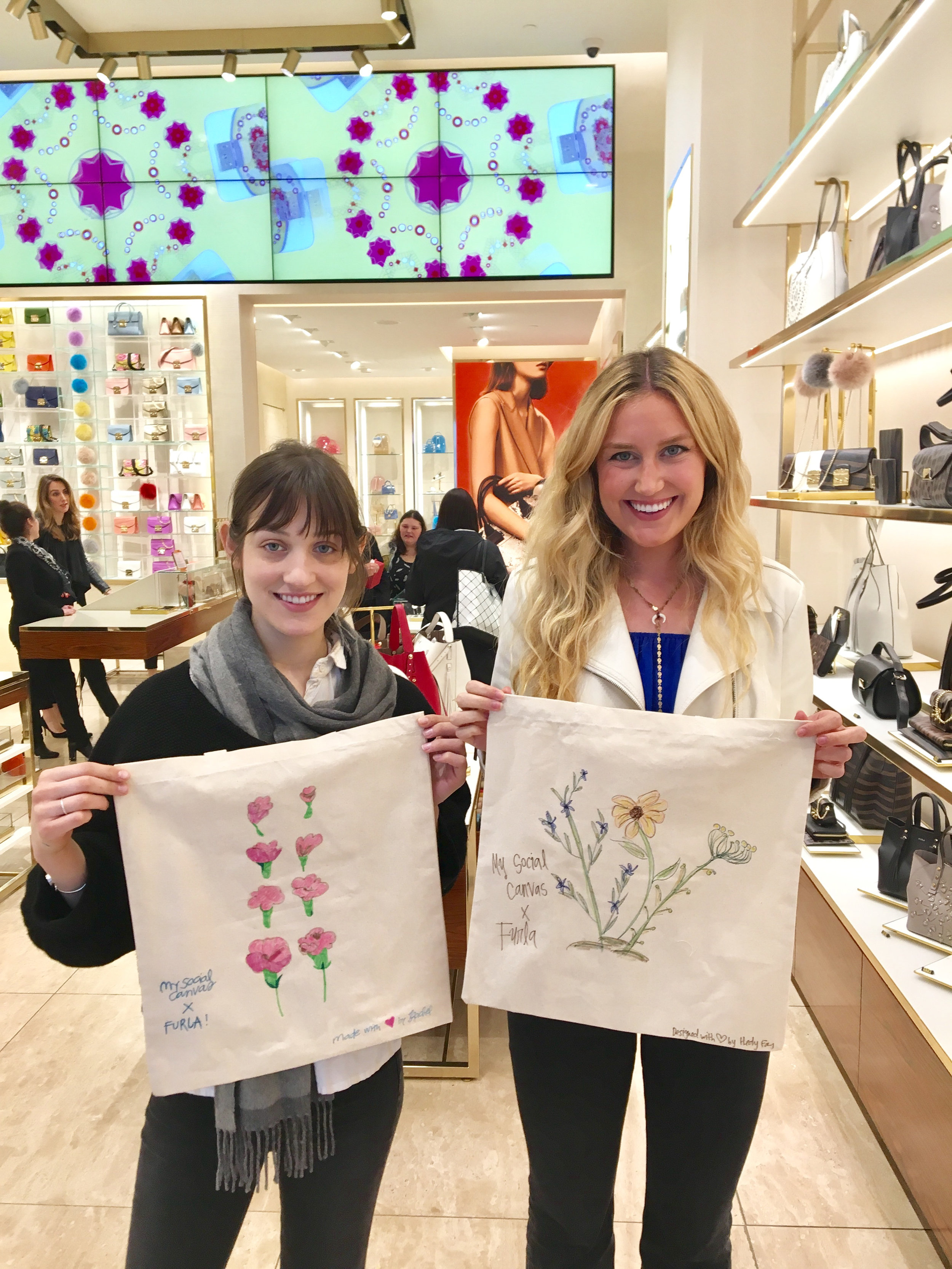 Campus Designer Rachel and MSC PR Coordinator, Hedy share their custom tote designs at our FURLA Earth Day event! Furla and their clients loved the floral patterns our campus designers created in celebration of Earth Day.
