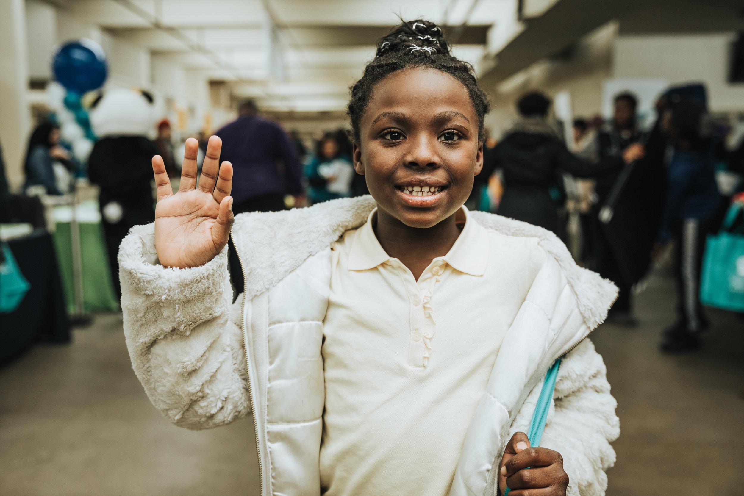 Young Girl Waving At SCF