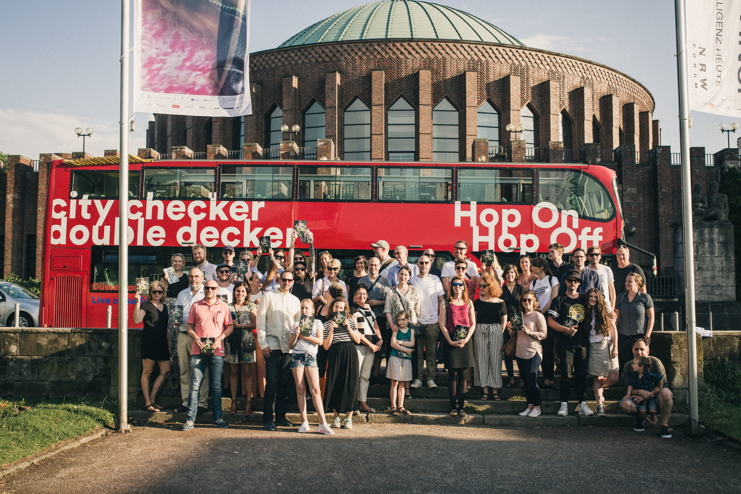 HopOn HopOff doubledecker bus at Ehrenhof in front of the Tonhalle Photo Credit: Kristina Fendesack / THE DORF