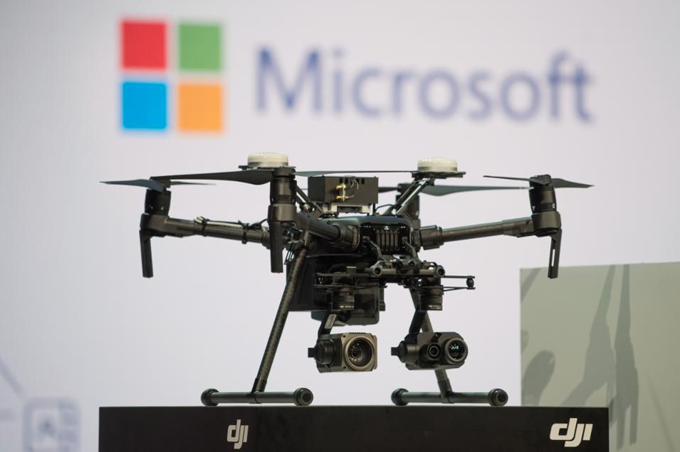 A SZ DJI Technology Co. drone is displayed during keynote presentations on artificial intelligence at the Microsoft Developers Build Conference in Seattle, Washington, U.S., on Monday, May 7, 2018. Photographer: Grant Hindsley/Bloomberg © 2018 BLOOMBERG FINANCE LP