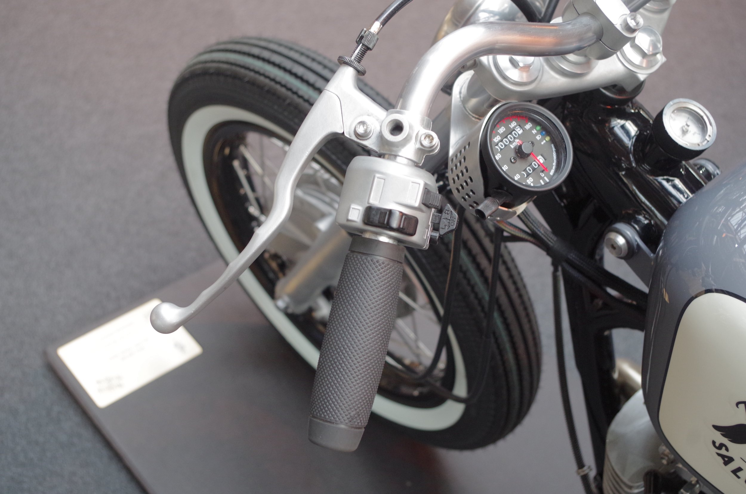 Neat fork mounted speedo basket is a one-off fabricated by Jamie
