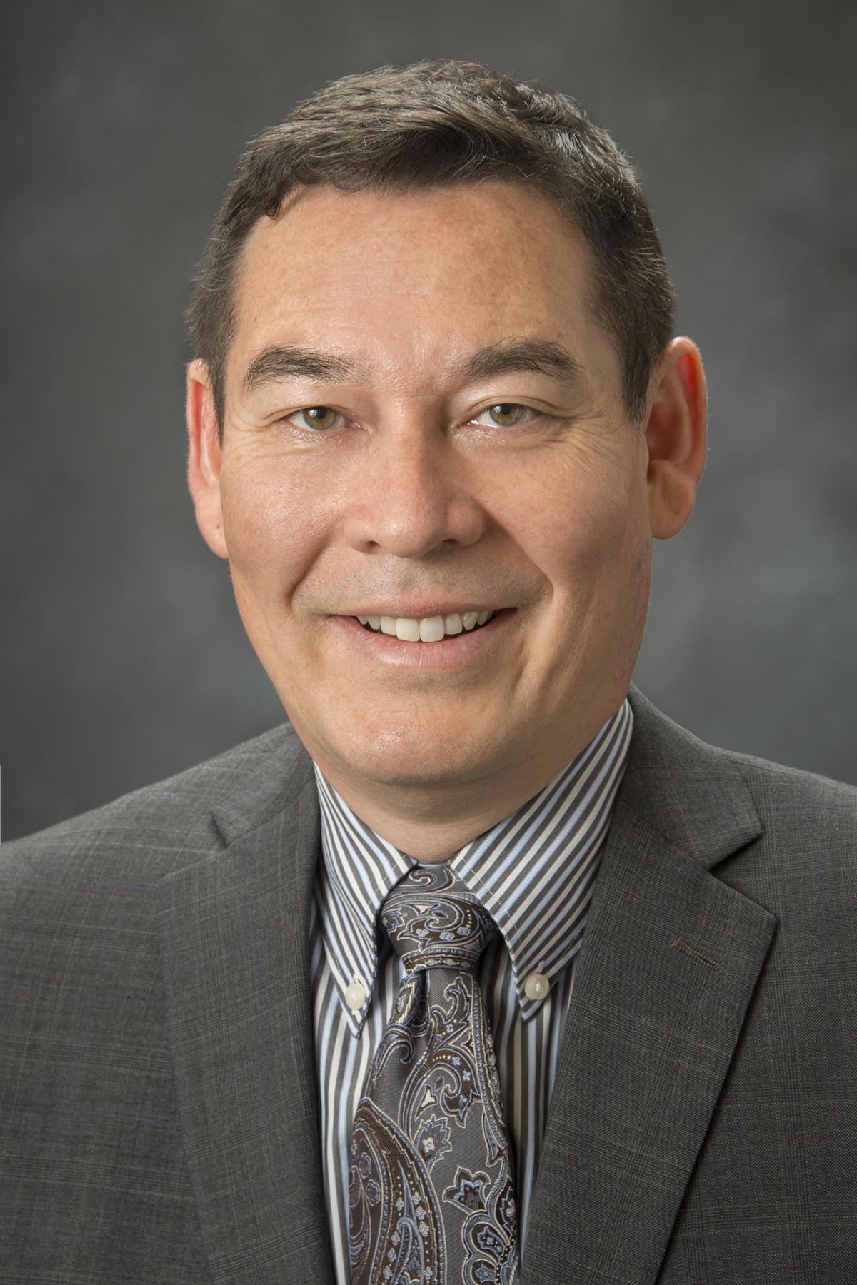 Michael R. Mark  Senior Partner