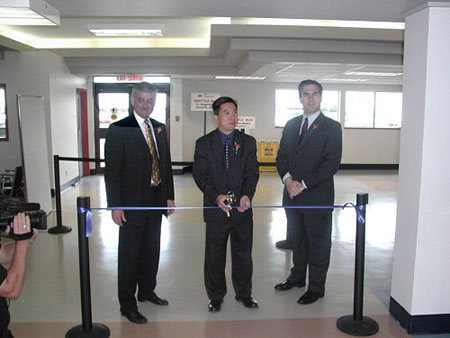 Cutting the ribbon for the Cruise Ship Terminal with Mayor Lowe and Michael Cormier
