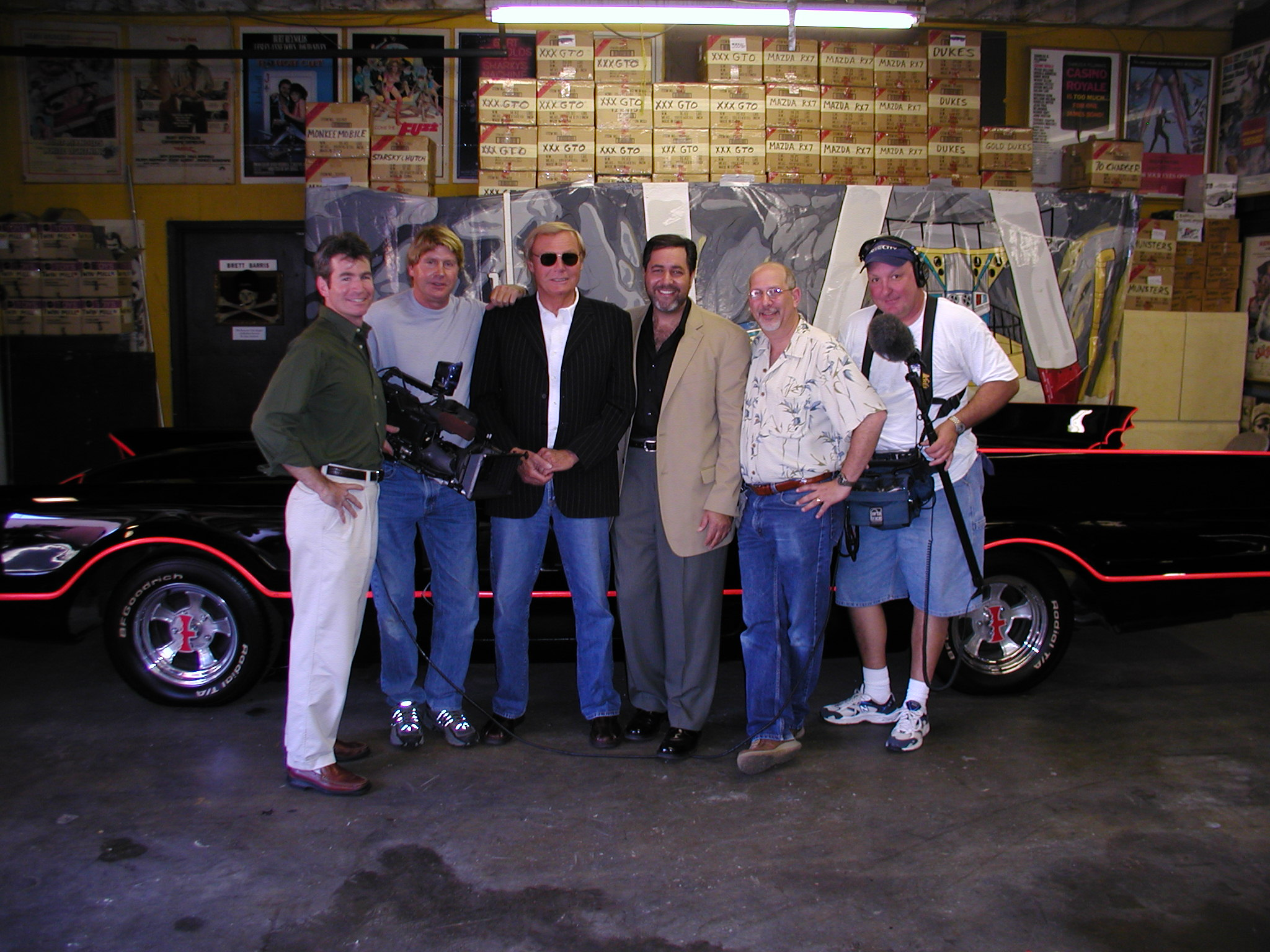 Adam West, the original batman with our crew in front of the world's most famous automobile - the original Batmobile