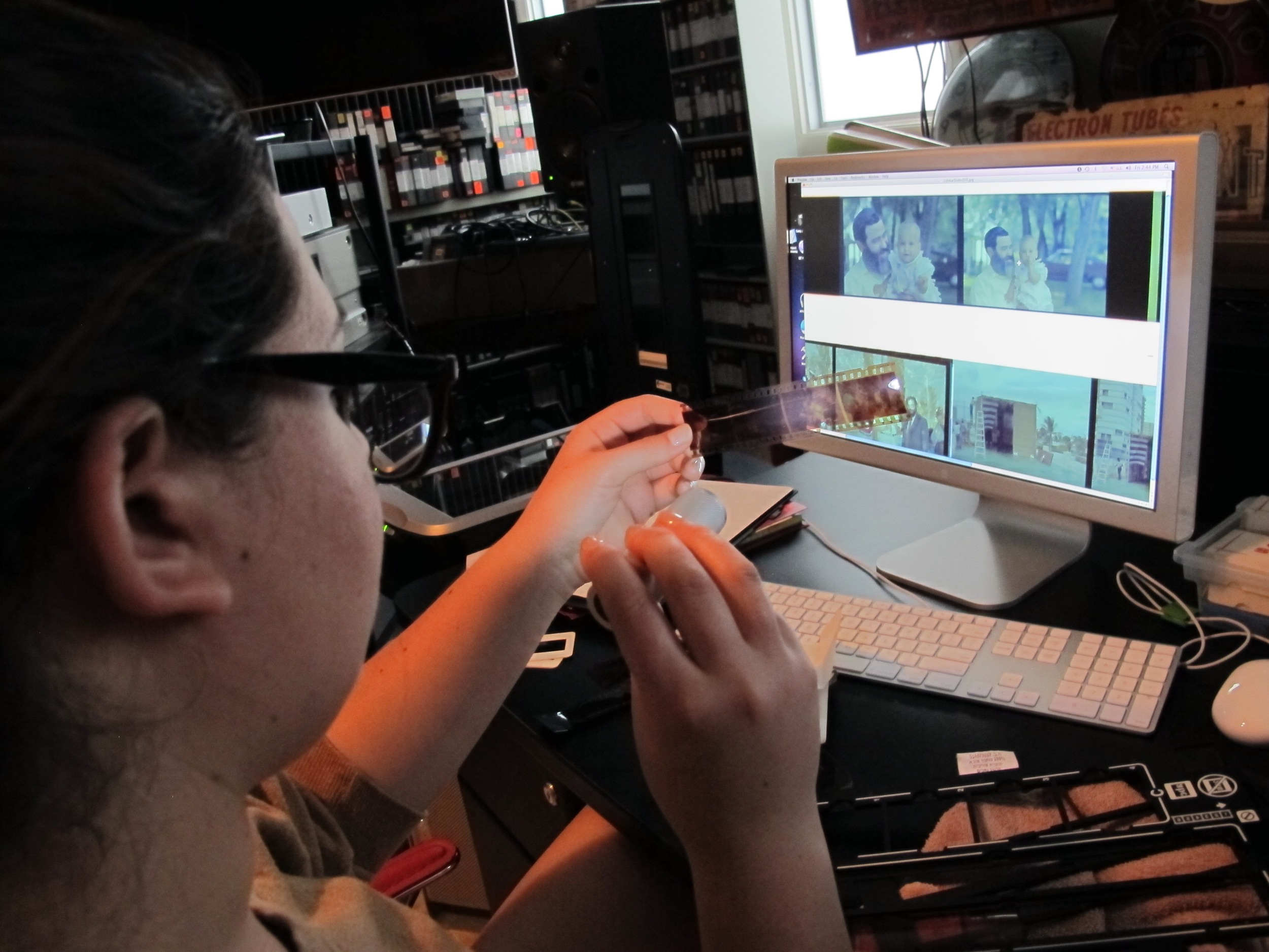 Sivan Levine digitizing 35mm negatives for a Family Documentary