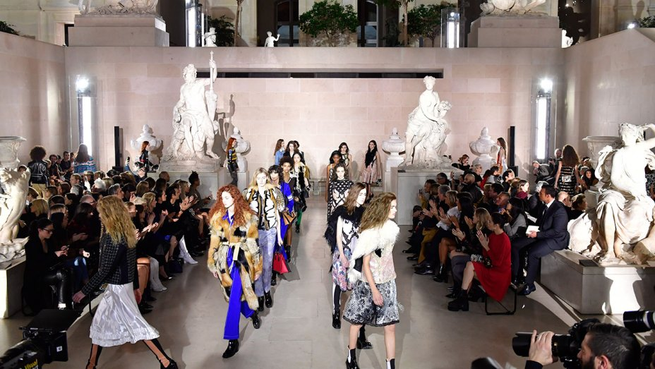 Dramatic entrance to runway with Neoclassical sculptures flanking the runway.