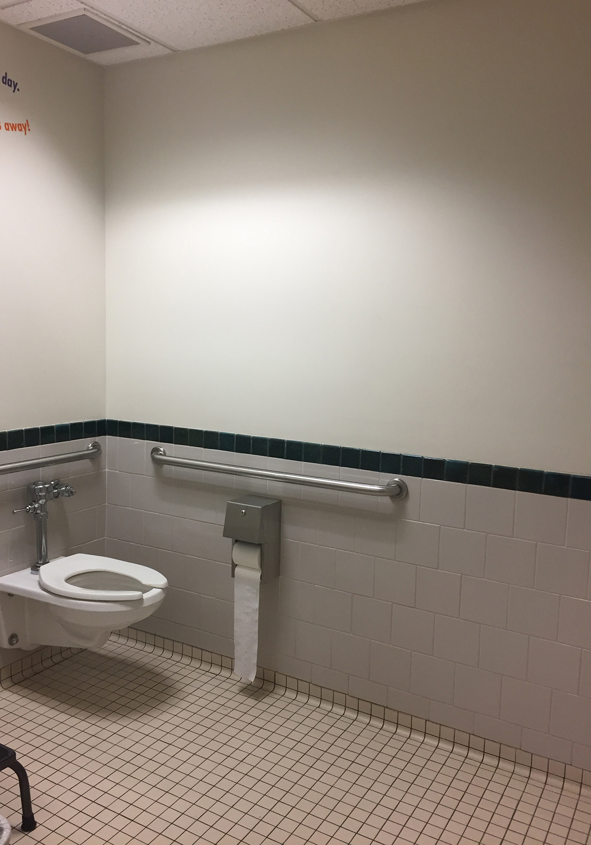 Off-white walls in the attached restroom.