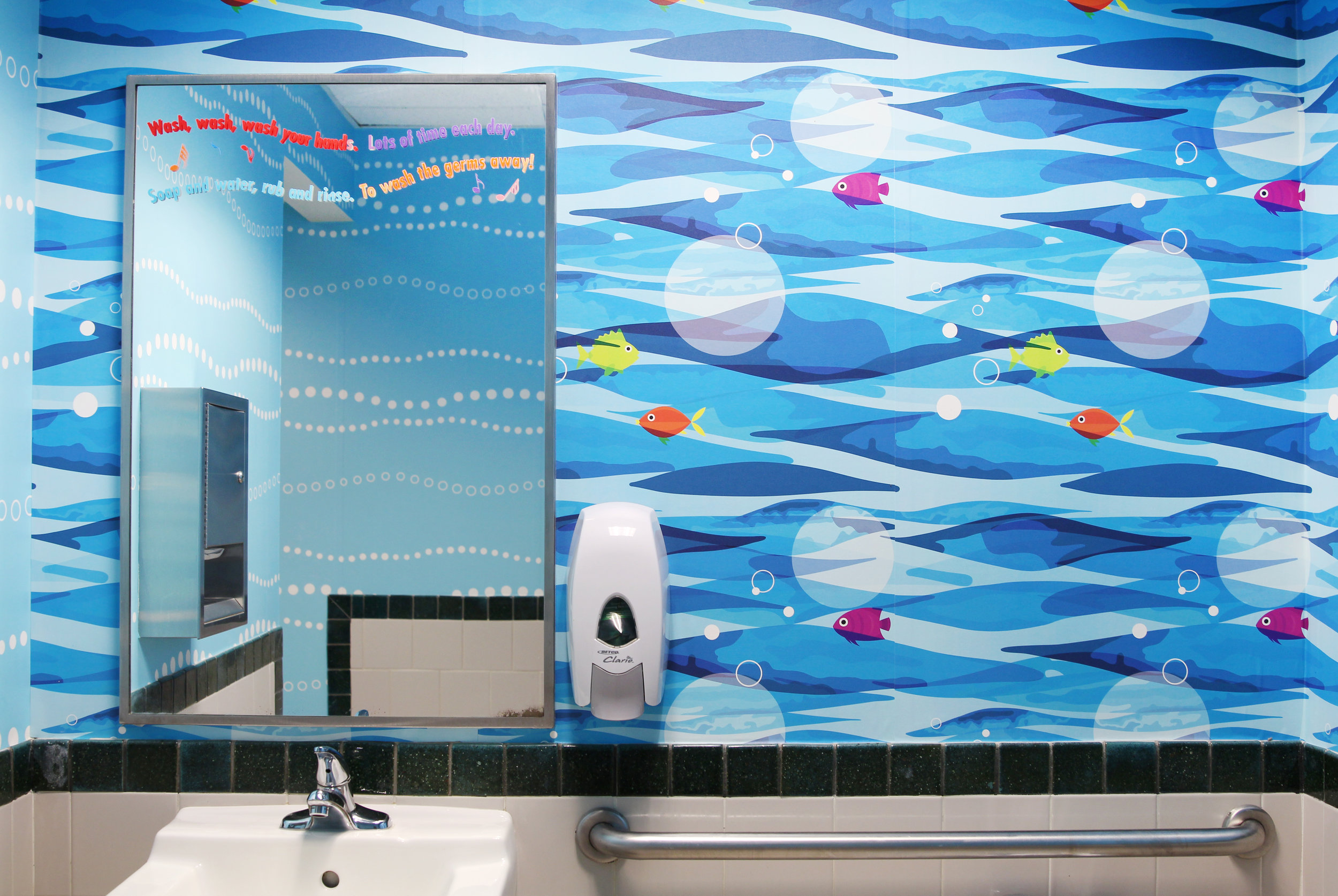 Here, you can see both custom patterns, the fish along one wall and the fun blue and white bubbles reflected in the mirror.