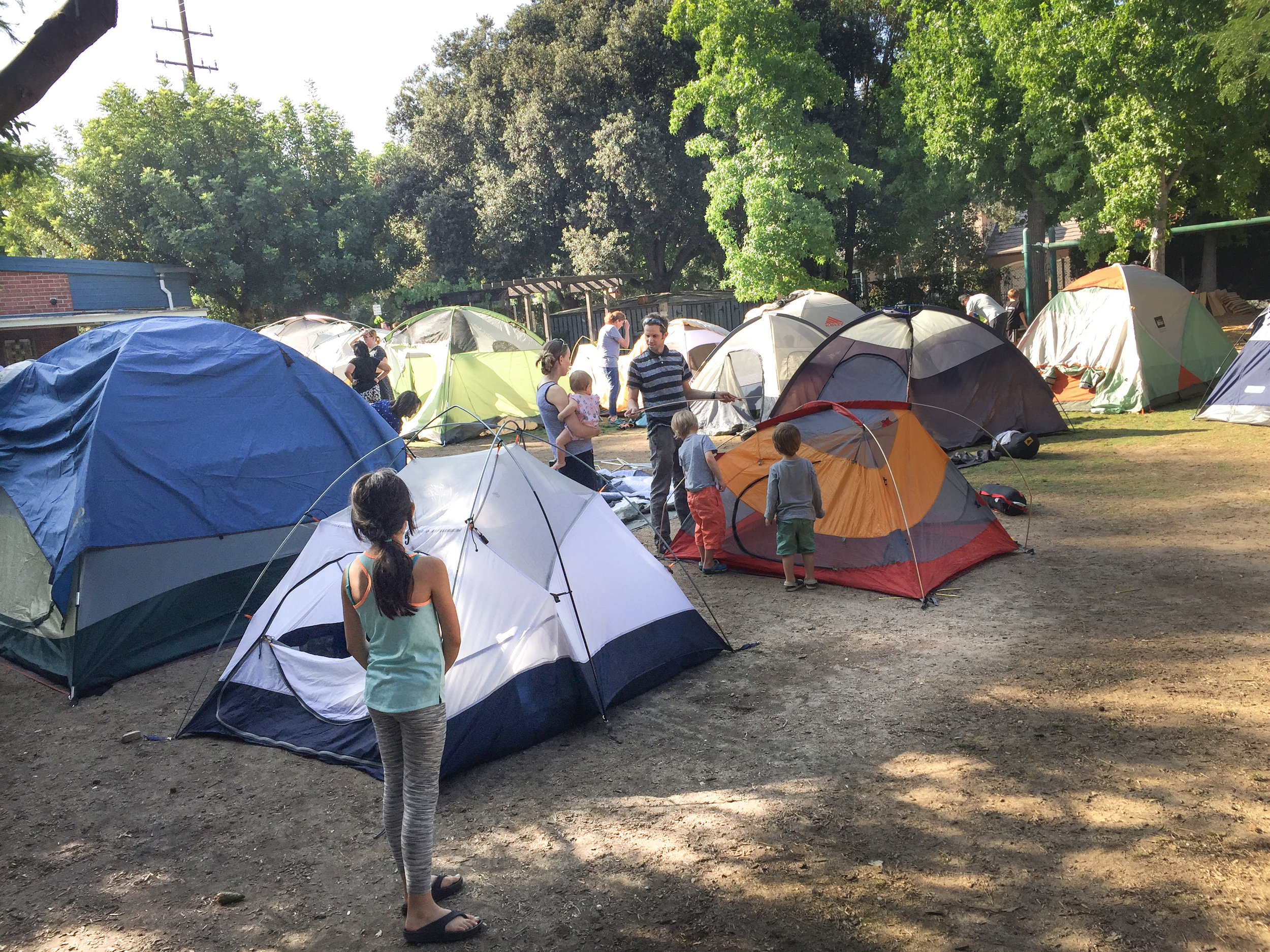 Families prepare for the annual Preschool Yard Camp Out