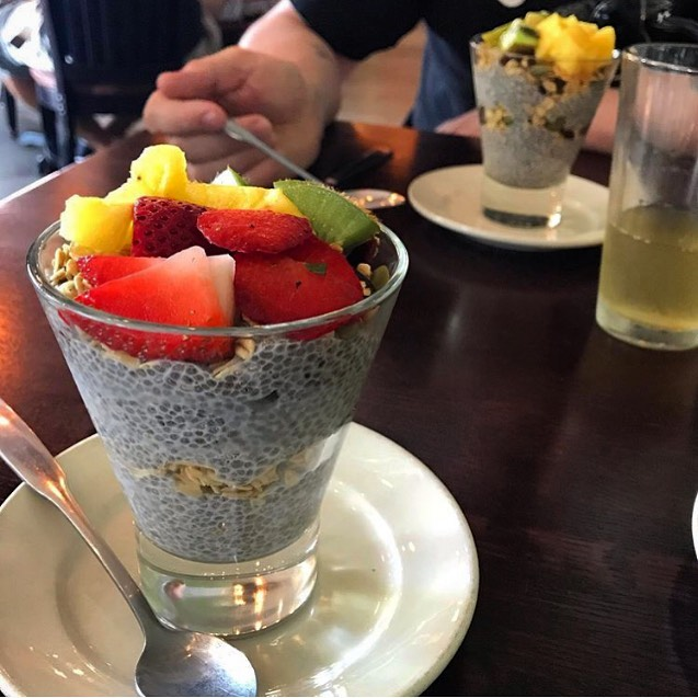 Our chia parfait's light, fresh, and full of plant protein. House-made chia pudding, granola, and topped with fresh fruit. 🍓🌿🍍🌤💪 📸@goodwitchkitchen