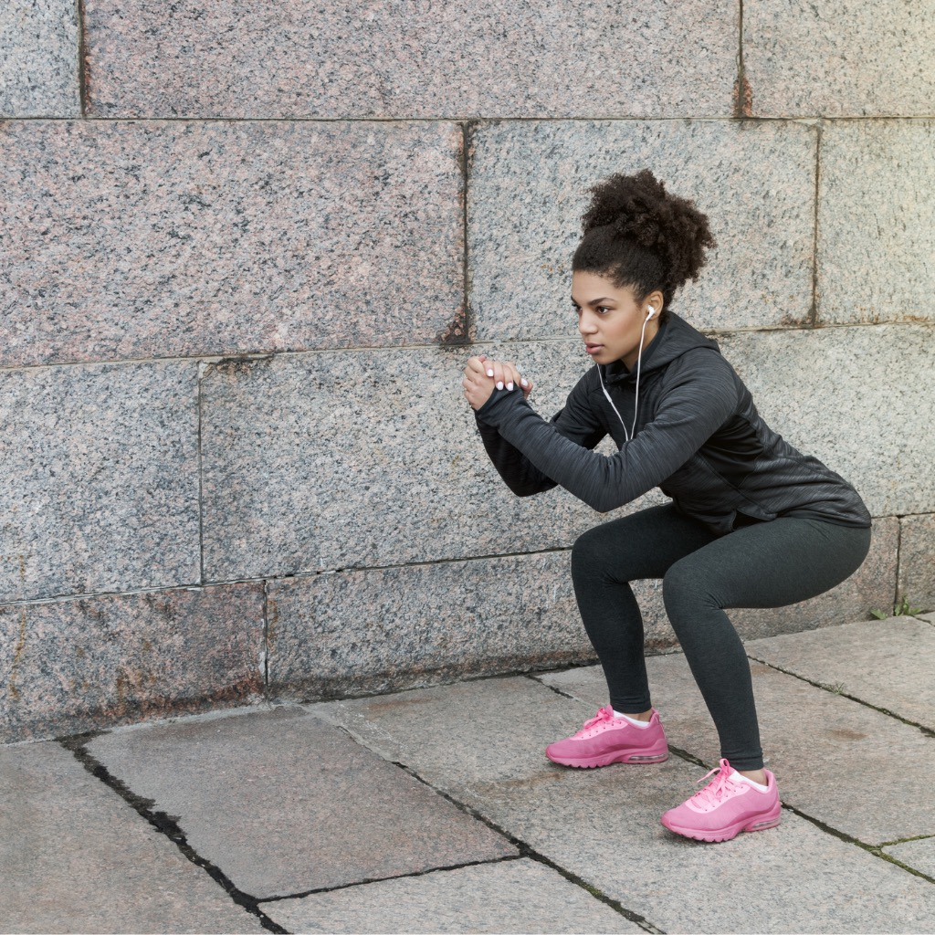 iStock - sporty-woman-doing-warm-up-squat-stretching-near-a-wall-picture-id622324774.jpg