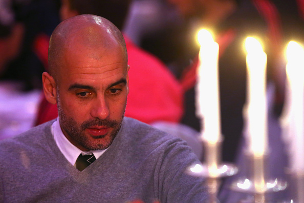 Guardiola at a candle-light party? (Photo via Getty Images)