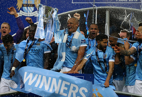 LONDON, ENGLAND - FEBRUARY 28 : Vincent Kompany of Manchester City lifts the cup as Manchester City celebrate with the Capital One cup trophy after the Capital One Cup Final match between Liverpool and Manchester City at Wembley Stadium on February 28, 2016 in London, England. (Photo by Catherine Ivill - AMA/Getty Images)