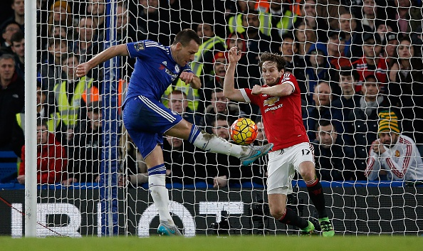 Chelsea's English defender John Terry (L) has a shot on goal blocked by Manchester United's Dutch midfielder Daley Blind during the English Premier League football match between Chelsea and Manchester United at Stamford Bridge in London on February 7, 2016. (Photo by ADRIAN DENNIS/AFP/Getty Images)