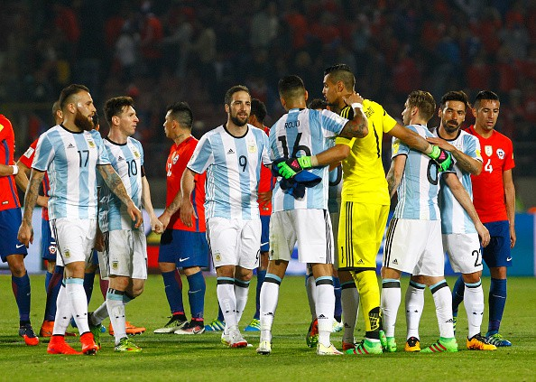 SANTIAGO, CHILE - MARCH 24: Players of Argentina celebrates after a match between Chile and Argentina as part of FIFA 2018 World Cup Qualifiers at Nacional Stadium on March 24, 2016 in Santiago, Chile. (Photo by Alex Reyes/LatinContent/Getty Images)