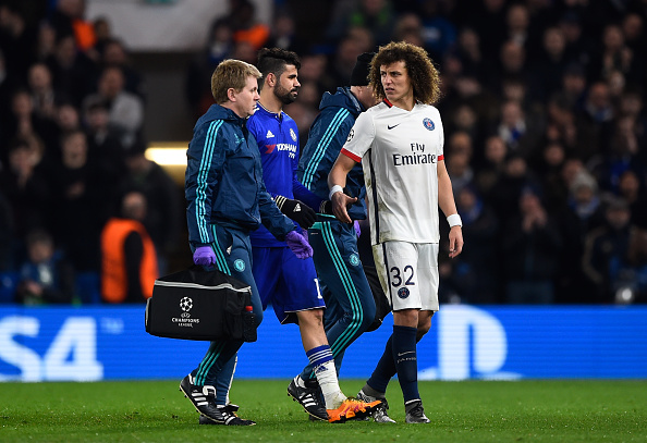 Diego Costa leaves the pitch after suffering an injury during the match between Chelsea and PSG. (Photo by Mike Hewitt/Getty Images)