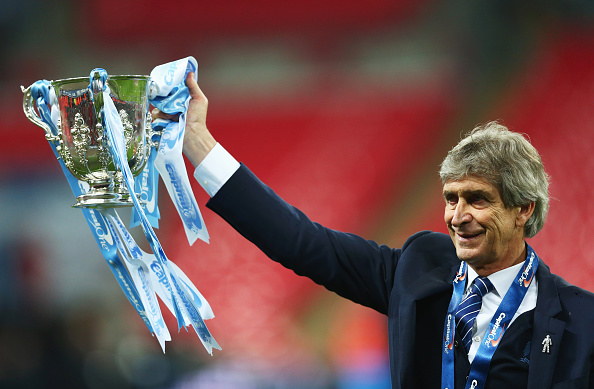 LONDON, ENGLAND - FEBRUARY 28: Manuel Pellegrini manager of Manchester City celebrates victory with the trophy after the Capital One Cup Final match between Liverpool and Manchester City at Wembley Stadium on February 28, 2016 in London, England. Manchester City win 3-1 on penalties. (Photo by Clive Brunskill/Getty Images)